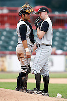 June 25, 2009:  Pitcher Randy Newsom (29) of the Altoona Curve talks with catcher Milver Reyes during a game at Jerry Uht Park in Erie, PA.  The Altoona Curve are the Eastern League Double-A affiliate of the Pittsburgh Pirates.  Photo by:  Mike Janes/Four Seam Images