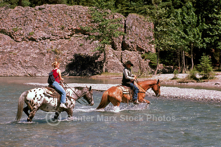Banff National Park, Canadian Rockies, AB, Alberta, Canada - Horseback Riding across the Spray River, Summer