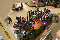 """An overview of  Orange Coast College's Ornamental Horticulture Club's in-progress installation at the 2012 South Coast Plaza Spring Garden Show in Costa Mesa, CA, seen from the second floor of the mall.  The theme for this year's show is """"healing gardens"""", and the OCC team is installing a """"garden for the blind,"""" which will be complete with a braille world globe and braille labels.  This picture was taken Tuesday April 25, 2012 at ~11pm, as the team was working frantically to meet their Thursday-morning deadline."""
