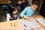 Education Elementary School New York Grade 3 mathematics children playing homemade game horizontal two girls playing
