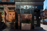 """On December 7, 2020, Delux Cafe, a restaurant and bar in Boston's South End, announced a temporary closure due to the ongoing coronavirus pandemic. The restaurant's hibernation will continue until further notice, according to a note posted to Instagram. Signs on the exterior of the restaurant read """"Delux is temporarily closed / We'll miss you / Merry Christmas / Happy New Year / See Ya Later 2020 / Stay Safe / Take Care of Each Other"""" and """"Thanks to our amazing neighbors, regulars and friends. We can't wait to see you all again,"""" in Boston, Massachusetts, on Sun., Jan. 10, 2021. The sign also includes the name of a Venmo account for people to contribute to a fund supporting Delux's employees."""