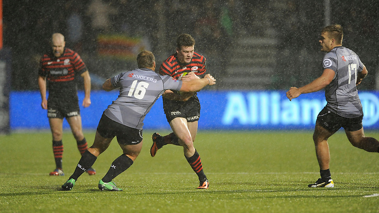 Duncan Taylor of Saracens is tackled by Kyle Cooper of Sharks during the Sanlam Private Investments Shield match between Saracens and the Cell C Sharks at Allianz Park on Saturday 25th January 2014 (Photo by Rob Munro)