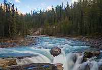The upper Athabasca River flows into a Athabasca Falls, Jasper National Park, Alberta, Canada.