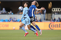 SAN JOSE, CA - MAY 22: Daniel Salloi #20 of Sporting Kansas City is defended by Florian Jungwirth #23 of the San Jose Earthquakes during a game between Sporting Kansas City and San Jose Earthquakes at PayPal Park on May 22, 2021 in San Jose, California.