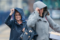 Wednesday  29 June 2016<br /> Pictured:Women hold on to their hoods as they  walk along the promenade in Porthcawl, South Wales <br /> Re: Rain and wind continues to batter parts of the UK