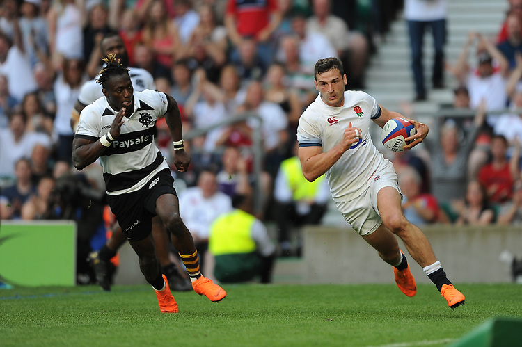 Jonny May of England runs in a try past Niyi Adeolokun (Connacht & Ireland) of Barbarians during the Quilter Cup match between England and Barbarians at Twickenham Stadium on Sunday 27th May 2018 (Photo by Rob Munro/Stewart Communications)