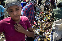 A Nicaraguan girl works in the garbage dump La Chureca, Managua, Nicaragua, 9 November 2004. La Chureca is the biggest garbage dump in Central America. Hundreds of trash recollectors search in tons of smouldering garbage mainly metals (copper, aluminium), others concentrate on glass which is cheap, but in bigger amount. The majority of the recyclers are families with children for whom recycling is a regular job. The children very often eat the food they find on the dump, none of them goes to school, they suffer from skin diseases, they have high levels of lead and DDT in blood.