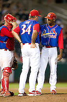 Samuel Freeman (12) of the Springfield Cardinals talks with pitching coach Bryan Eversgerd (34) and catcher Charles Cutler (37) during a game against the Corpus Christi Hooks at Hammons Field on August 13, 2011 in Springfield, Missouri. Springfield defeated Corpus Christi 8-7. (David Welker / Four Seam Images)