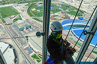 QATAR, Doha, aspire dome and sportspark at Khalifa International Stadium for FIFA world cup 2022, Filipino migrant worker work as window cleaner at Aspire tower / KATAR, Doha, Fussballfelder und Sportpark am Khalifa International Stadium fuer die  FIFA Fussballweltmeisterschaft 2022, philippinische Gastarbeiter arbeiten als Fensterreiniger am Aspire Tower