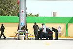 Several attendants prepare to fill gas.<br /> (2)