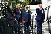 """From left to right: Sheikh Abdullah bin Zayed bin Sultan Al Nahyan, Minister of Foreign Affairs and International Cooperation of the United Arab Emirates; Dr. Abdullatif bin Rashid Alzayani, Minister of Foreign Affairs, Kingdom of Bahrain; Prime Minister Benjamin Netanyhu of Israel; and United States President Donald J. Trump wave from the South Portico steps at the conclusion of the signing ceremony of the """"Abraham Accords"""" on the South Lawn of the White House in Washington, DC on Tuesday, September 15, 2020. <br /> Credit: Chris Kleponis / Pool via CNP"""