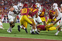 LOS ANGELES, CA - SEPTEMBER 11: Barrett Miller #63 and Walter Rouse #75 of the Stanford Cardinal block for a run during a game between University of Southern California and Stanford Football at Los Angeles Memorial Coliseum on September 11, 2021 in Los Angeles, California.