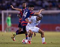 SAN PEDRO SULA, HONDURAS - SEPTEMBER 8: Andy Najar #17 of Honduras is defended by Ricardo Pepi #14 of the United States during a game between Honduras and USMNT at Estadio Olímpico Metropolitano on September 8, 2021 in San Pedro Sula, Honduras.