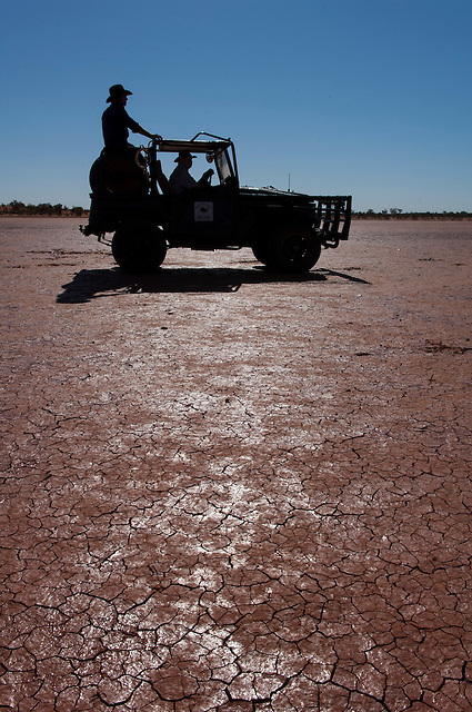 Camel catchers in toyota on desert claypan,  Central Australia, Northern Territory, Australia.
