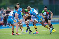 20130803 Copyright onEdition 2013 ©<br />Free for editorial use image, please credit: onEdition.<br /><br />Jeremy Manning of Harlequins 7s is tackled by Tom Varndell of London Wasps 7s during the J.P. Morgan Asset Management Premiership Rugby 7s Series.<br /><br />The J.P. Morgan Asset Management Premiership Rugby 7s Series kicks off for the fourth season on Thursday 1st August with Pool A at Kingsholm, Gloucester with Pool B being played at Franklin's Gardens, Northampton on Friday 2nd August, Pool C at Allianz Park, Saracens home ground, on Saturday 3rd August and the Final being played at The Recreation Ground, Bath on Friday 9th August. The innovative tournament, which involves all 12 Premiership Rugby clubs, offers a fantastic platform for some of the country's finest young athletes to be exposed to the excitement, pressures and skills required to compete at an elite level.<br /><br />The 12 Premiership Rugby clubs are divided into three groups for the tournament, with the winner and runner up of each regional event going through to the Final. There are six games each evening, with each match consisting of two 7 minute halves with a 2 minute break at half time.<br /><br />For additional images please go to: http://www.w-w-i.com/jp_morgan_premiership_sevens/<br /><br />For press contacts contact: Beth Begg at brandRapport on D: +44 (0)20 7932 5813 M: +44 (0)7900 88231 E: BBegg@brand-rapport.com<br /><br />If you require a higher resolution image or you have any other onEdition photographic enquiries, please contact onEdition on 0845 900 2 900 or email info@onEdition.com<br />This image is copyright the onEdition 2013©.<br /><br />This image has been supplied by onEdition and must be credited onEdition. The author is asserting his full Moral rights in relation to the publication of this image. Rights for onward transmission of any image or file is not granted or implied. Changing or deleting Copyright information is illegal as specified in the Copyright, Design 