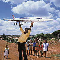 Metal artist Titus Moteyane holds up his piece based on a British Airways Concorde plane in the Atteridgeville township.