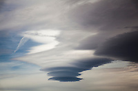 Shades of gray and a patch of blue - a lenticular cloud formation over the Arizona desert.