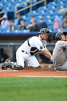 Lake County Captains catcher Richard Stock (28) tags out Sammy Diaz (5) attempting to score a run during a game against the Dayton Dragons on June 8, 2014 at Classic Park in Eastlake, Ohio.  Lake County defeated Dayton 4-2.  (Mike Janes/Four Seam Images)