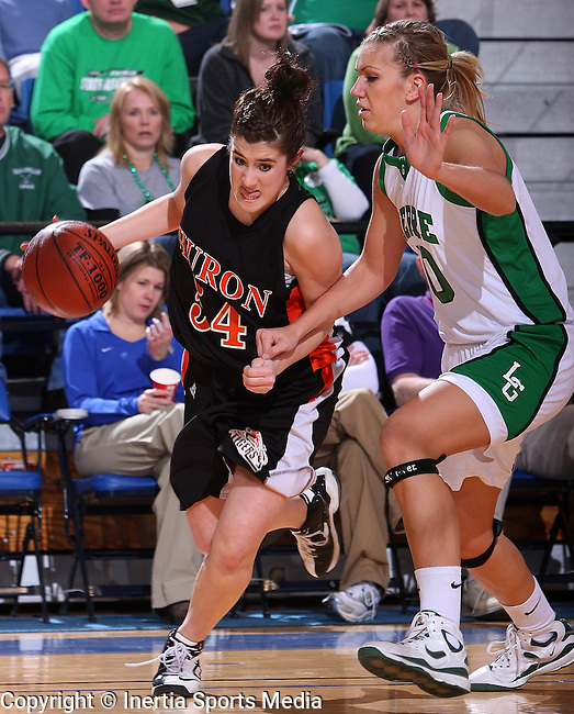 BROOKINGS, SD - March 12, 2009 : Brittany Hirschkorn #54 of Huron drives baseline around Katie Lingle #50 of Pierre during their State Girls AA Tournament at Frost Arena in Brookings, SD on Thursday. (Photo By Stephen Brua/ Inertia)