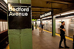 Commuters wait for a train at the Bedford Avenue subway in Williamsburg near the East River in Brooklyn, New York.