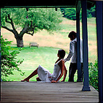Couple sitting on edge of porch