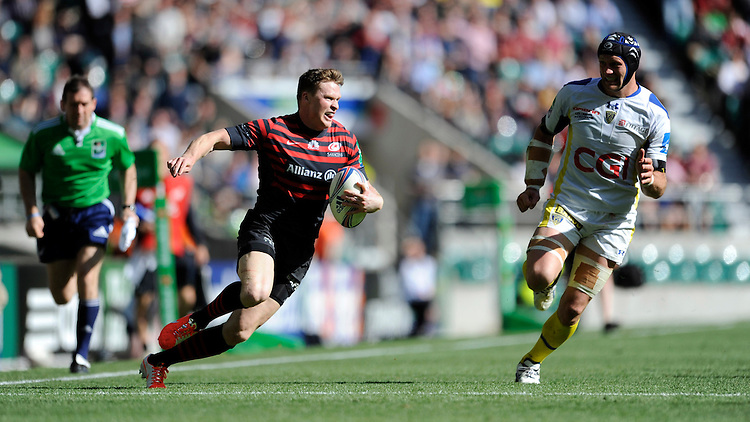 Chris Ashton of Saracens accelerates past Julien Bonnaire of ASM Clermont Auvergne during the Heineken Cup semi-final match between Saracens and ASM Clermont Auvergne at Twickenham Stadium on Saturday 26th April 2014 (Photo by Rob Munro)