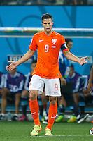 Robin van Persie of the Netherlands looks dejected