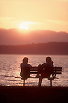 Seattle, two young women in conversation, Puget Sound, Olympic mountains, Washington State, Pacific Northwest, USA,