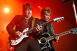 Richie Sambora and John Bon Jovi perform at the Lanier Law Firm's Holiday Bash Sunday Dec. 13,2009.(Dave Rossman/For the Chronicle)