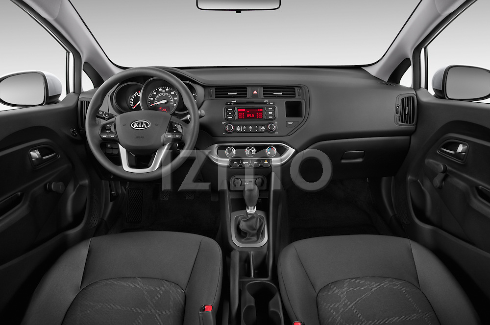 Stock photo of straight dashboard view of a 2015 KIA Rio LX AT 4 Door Sedan 2WD Dashboard
