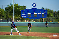 Los Angeles Dodgers Mitch Hansen (15) leads off second in front of shortstop Brendon Davis (7) during an instructional league game against the Milwaukee Brewers on October 13, 2015 at Cameblack Ranch in Glendale, Arizona.  (Mike Janes/Four Seam Images)