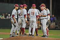 Florida State Seminoles head coach Mike Martin discusses the situation with his infield and pitcher Gage Smith #19 during a game against the Clemson Tigers at Doug Kingsmore Stadium on March 22, 2014 in Clemson, South Carolina. The Seminoles defeated the Tigers 4-3. (Tony Farlow/Four Seam Images)