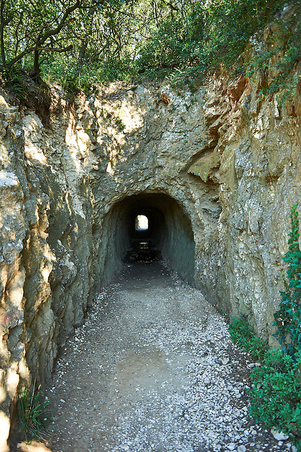 Picture of the water tunnel of the ancient Roman Aqueduct of the Pont du Gard which crosses the River Gardon near Vers-Pon-du-Gard, France. Part of the 50 km long aqueduct that served the Roman town of Nemausus (Nimes) its 3 tiers of arches stand 48 m high (160 ft). A UNESCO World Heritage Site.