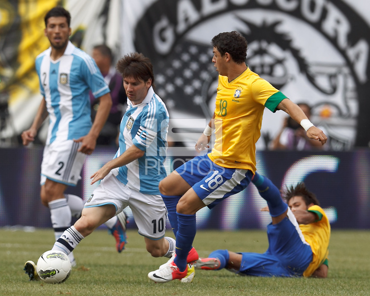 Argentina forward  Lionel Messi (10) dribbles as Brazil substitute midfielder Giuliano (18) defends. In an international friendly (Clash of Titans), Argentina defeated Brazil, 4-3, at MetLife Stadium on June 9, 2012.