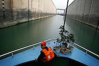 CHINA. Hubei Province. A boat passing through the 3 Gorges Dam.  The flooding of the three Gorges, by damming the Yangtze near the town of YiChang, has remained a controversial subject due to the negative environmental consequences and the displacement of millions of people in the flood plain. The Yangtze River however is reported to be at its lowest level in 150 years as a result of a country-wide drought. It is China's longest river and the third longest in the world. Originating in Tibet, the river flows for 3,964 miles (6,380km) through central China into the East China Sea at Shanghai.  2008.