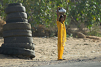On the road from Mandawa to Delhi, India, young women collecting water