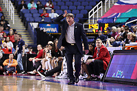 GREENSBORO, NC - MARCH 07: Head coach Wes Moore of North Carolina State University signals to his team during a game between Boston College and NC State at Greensboro Coliseum on March 07, 2020 in Greensboro, North Carolina.