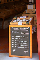 Wine shop. Special offer on a chalk board. The town. Saint Emilion, Bordeaux, France