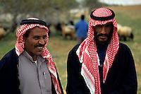 Portrait of two Bedouins wearing keffiehs, the traditional headwear, Jordan.
