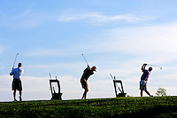 A group of golfers hit on the driving range in Charleston, SC.