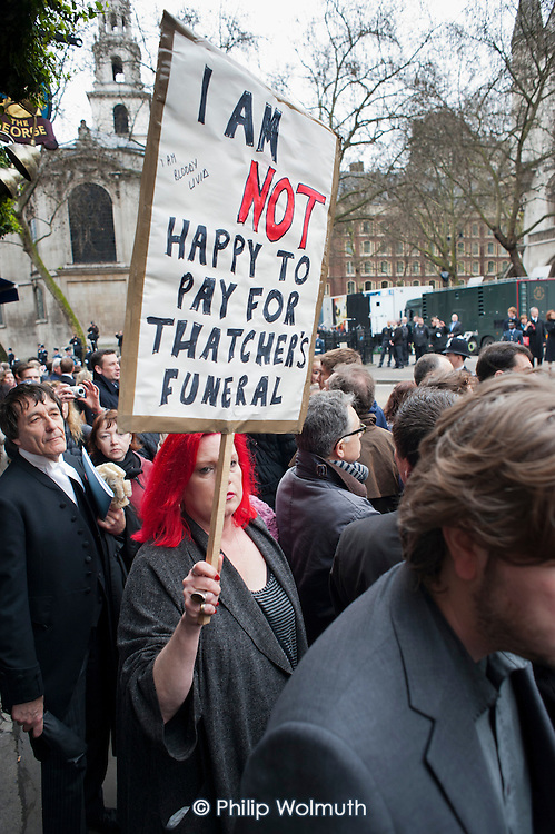 I am not happy to pay for Thatcher's funeral.  Protester at funeral of ex-Prime Minister Margaret Thatcher, City of London.