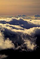 Ethereal clouds swirl at sunrise on the summit of Haleakala (House of the Sun) on the island of Maui.