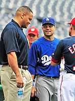24 April 2010: Los Angeles Dodgers' infielder Jamey Carroll (center) chats with Washington Nationals' director of travel Rob McDonald (left) prior to a game at Nationals Park in Washington, DC. The Dodgers edged out the Nationals 4-3 in a thirteen inning game. Mandatory Credit: Ed Wolfstein Photo