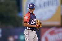 Hagerstown Suns relief pitcher Alfonso Hernandez (14) looks to his catcher for the sign against the Kannapolis Intimidators at Kannapolis Intimidators Stadium on August 27, 2019 in Kannapolis, North Carolina. The Intimidators defeated the Suns 5-4. (Brian Westerholt/Four Seam Images)
