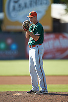 Greensboro Grasshoppers relief pitcher Brandon Miller (41) looks to his catcher for the sign against the Kannapolis Intimidators at Kannapolis Intimidators Stadium on August 5, 2018 in Kannapolis, North Carolina. The Intimidators defeated the Grasshoppers 9-0 in game two of a double-header.  (Brian Westerholt/Four Seam Images)