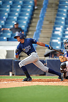 Delvin Perez (7) of Loiza, Puerto Rico playing for the Tampa Bay Rays scout team during the East Coast Pro Showcase on July 28, 2015 at George M. Steinbrenner Field in Tampa, Florida.  (Mike Janes/Four Seam Images)