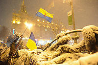 The barriicades in  independence square under a heavy snowfall. Kiev. Ukraine.  Tonight the  police is expected to forcedly evacuate the streets from the protesters blocking all the government buildings. Kiev. Ukraine