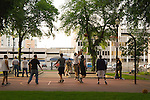 Group of men playing basketball, North Park Blocks, Portland, Oregon