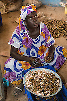 Woman Hulling Cashew Nuts.  Group Juboo Cashew Processing Center, Fass Njaga Choi, North Bank Region, The Gambia