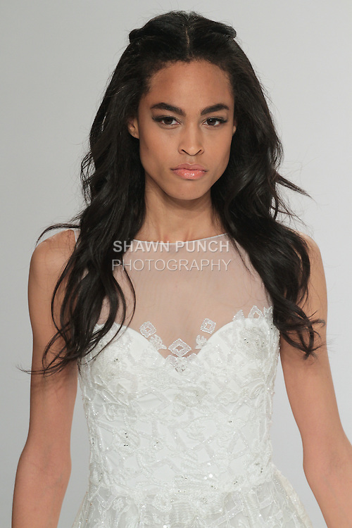 """Beauty shot: model walks runway in Epona - an off white A-line dress in silk-embroidered tulle with crystal embellishments, sweetheart neckline and a gathered waist, from the Tony Ward Fall 2016 """"A Mid-Summer Night's Dream"""" bridal collection on April 18, 2016 at Kleinfeld Bridal during New York Bridal Fashion Week Spring Summer 2016."""
